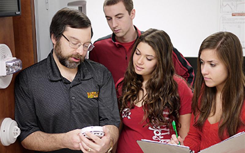 Professor of the practice Ken Isman instructing students